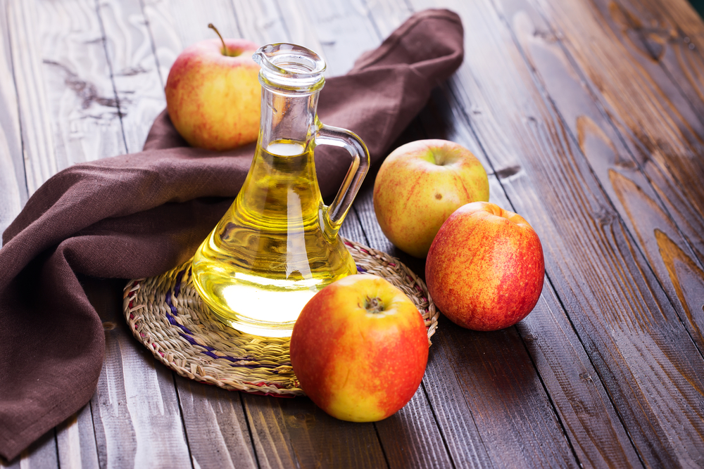 apple-cider-vinegar-on-wooden-floor