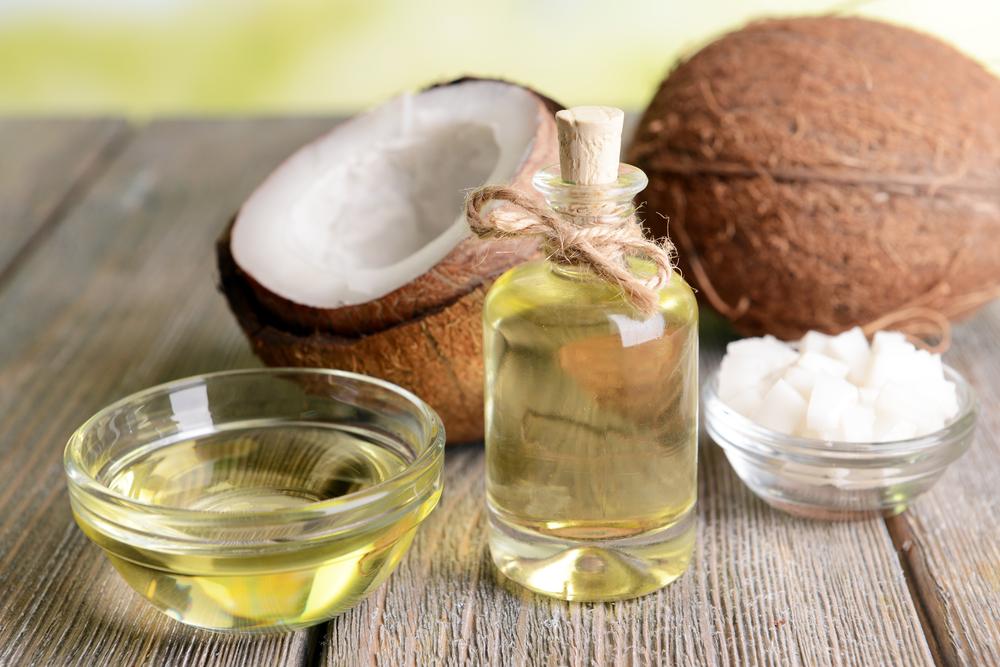 coconut-coconut-oil-on-wooden-floor