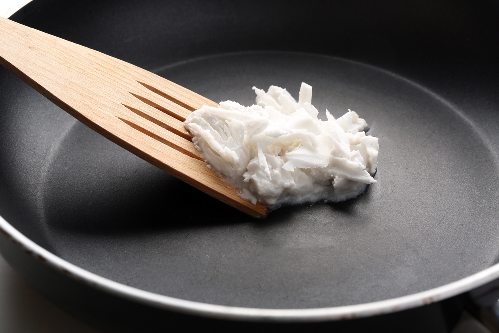 cooking-with-coconut-oil-on-a-frying-pan