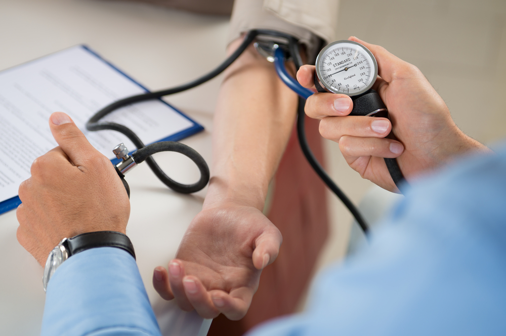 doctor-checking-blood-pressure