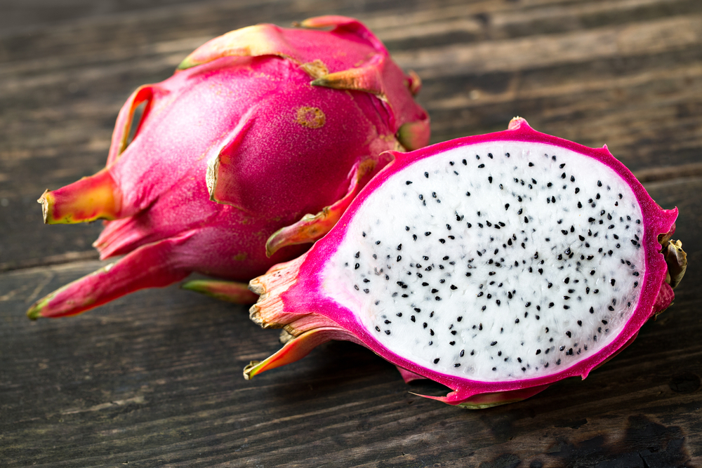 dragon-fruit-open-on-wooden-table