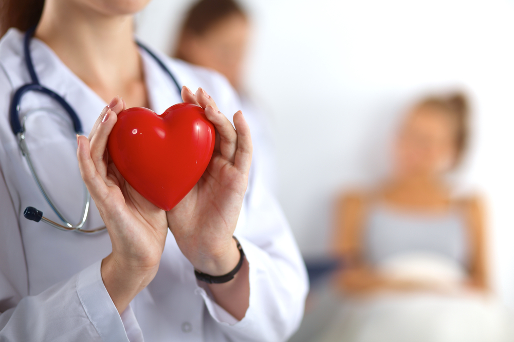 female-doctor-holding-a-heart-shape-heart