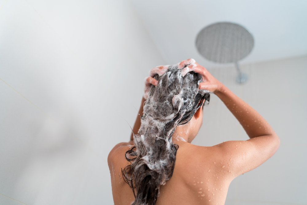 girl-shampoo-ing-her-hair-in-the-shower