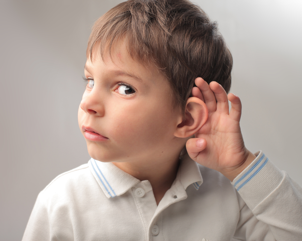 little-boy-curious-about-listening-to-something