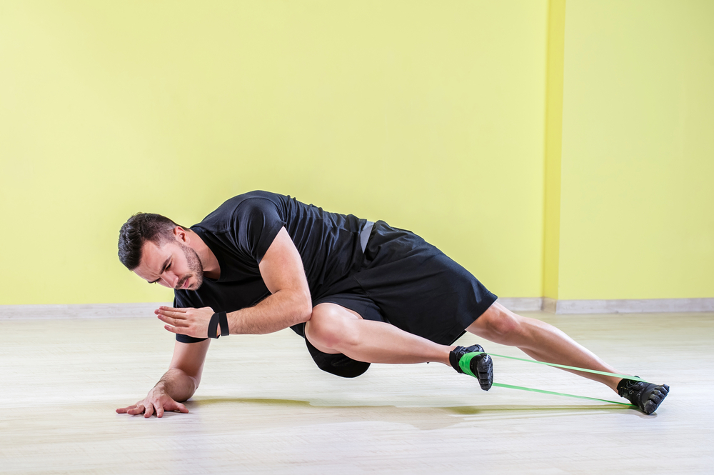 man-using-strength-or-stretch-band-while-doing-exercise