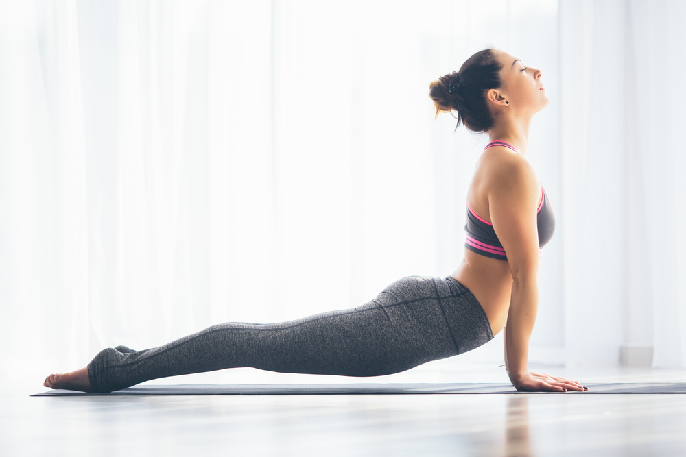 middleage-woman-doing-yoga-at-home