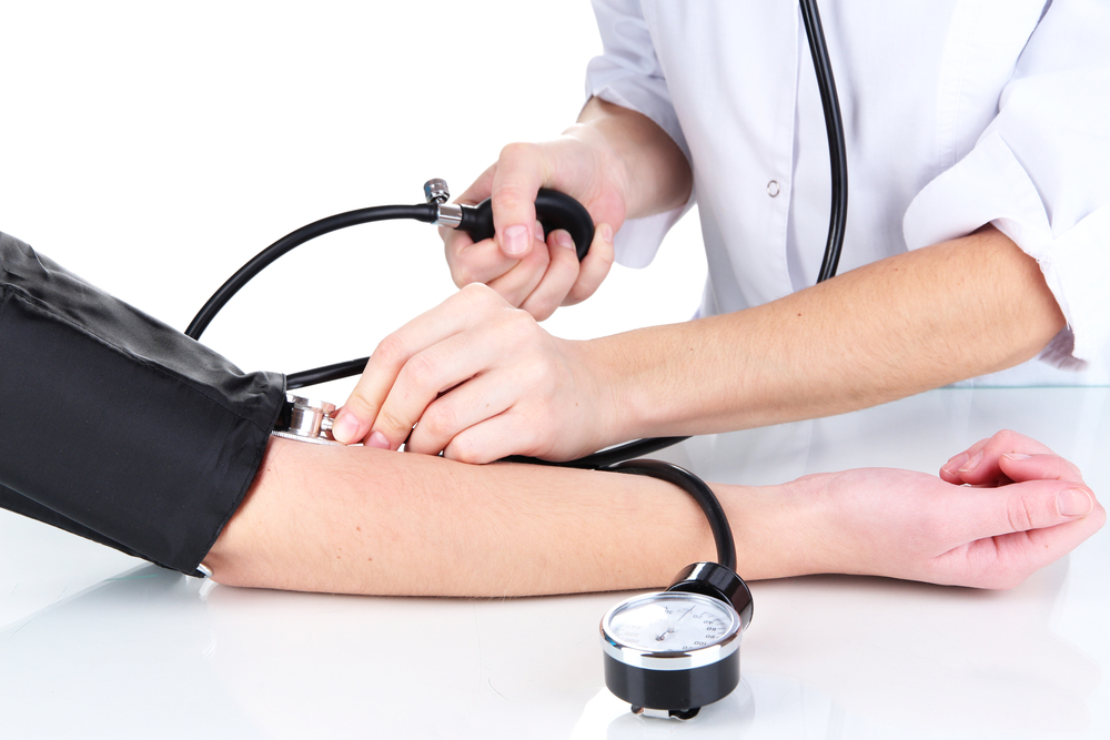 natural-ways-to-prevent-high-blood-pressure-nurse-taking-a-patient-blood-pressure