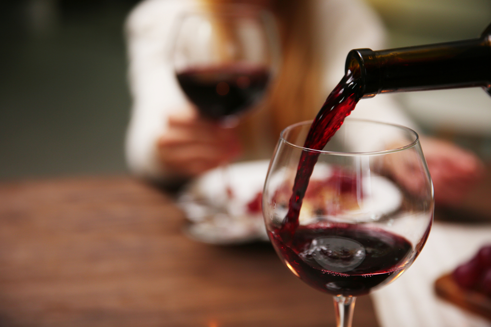 pouring-red-wine-into-a-wine-glass