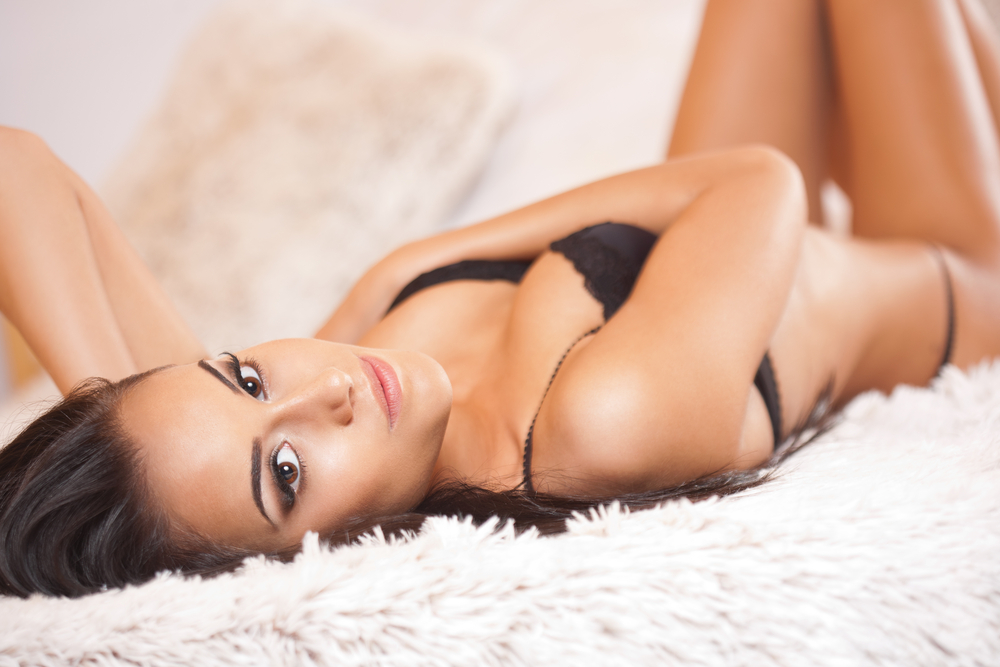 pretty-african-woman-lying-on-bed