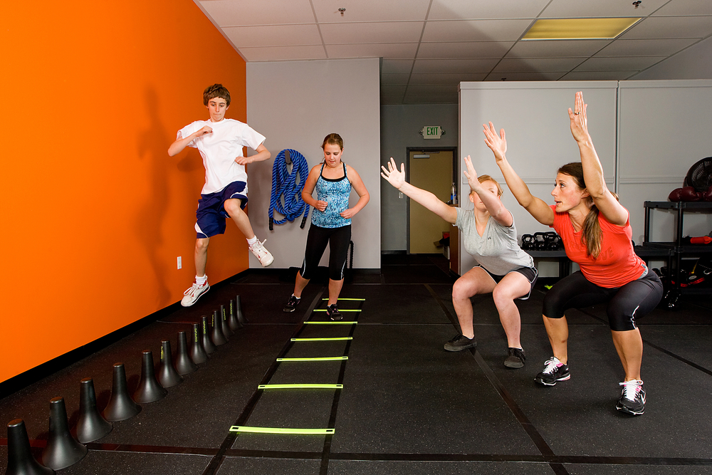 teenagers-playing-on-agility-ladder