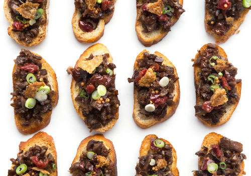 Duck Confit Crostini with Pickled Cherries and Duck Cracklings