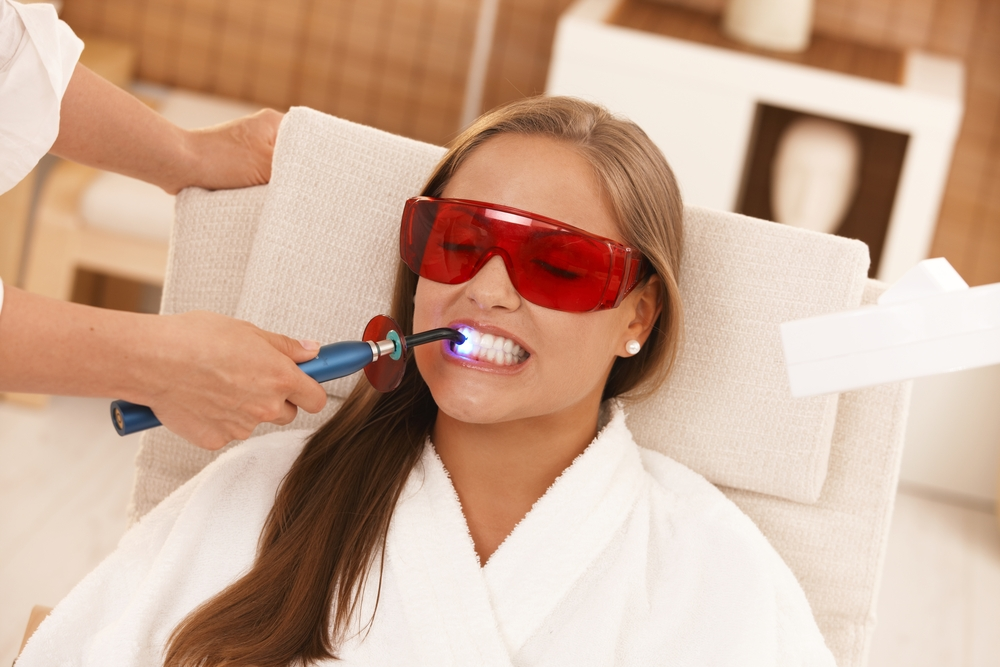 woman-doing-a-lazer-teeth-whitening-treadment