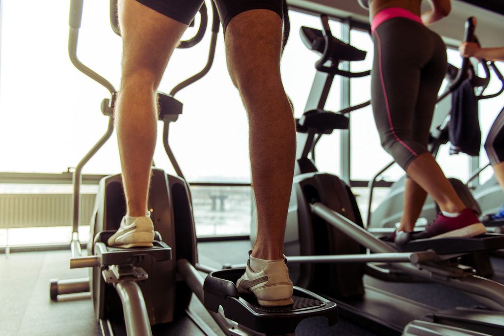 elliptical-machines-in-the-gym-young-people-using-them