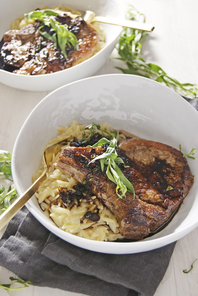 Seared Pork Chops with Balsamic Tarragon Glaze and Cheesy Orzo