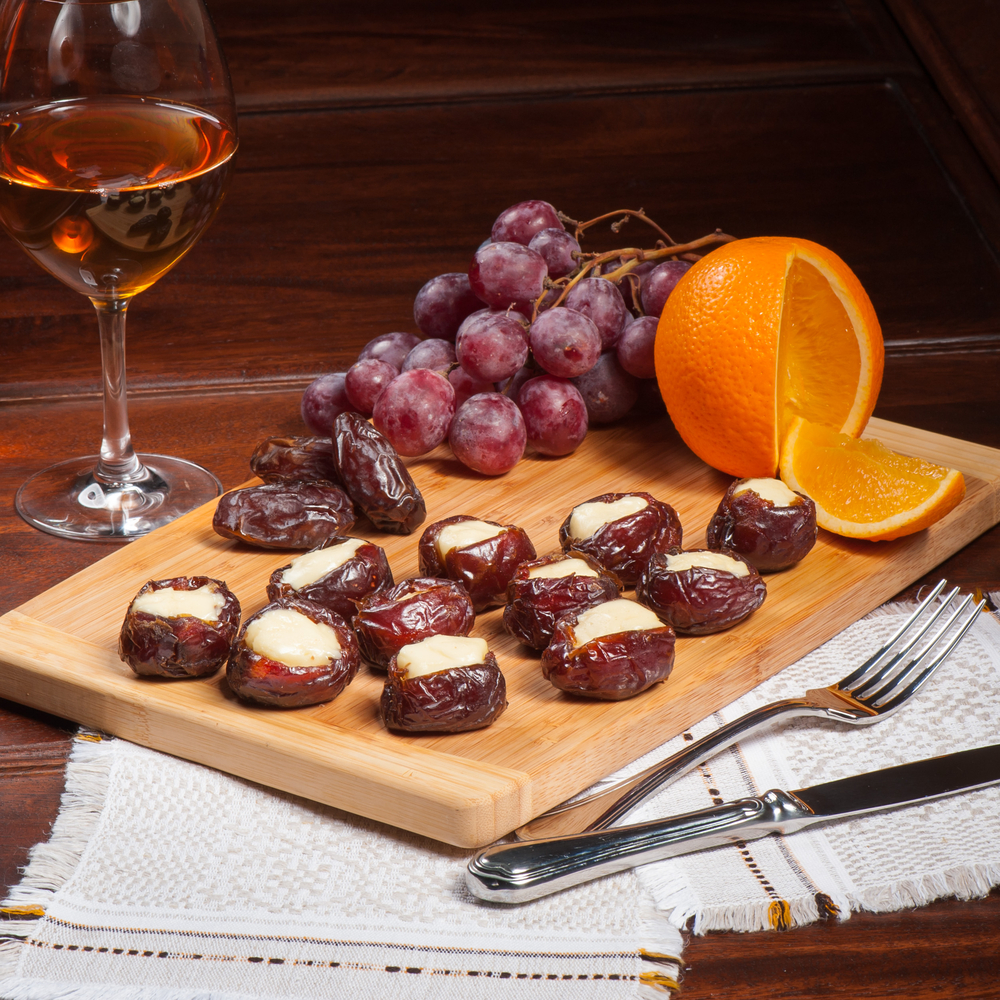 Dried dates stuffed with cheese served with white wine