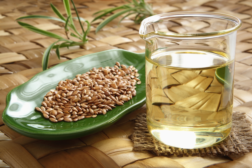 Flax Oil and Brown Flaxseeds - Featured Image