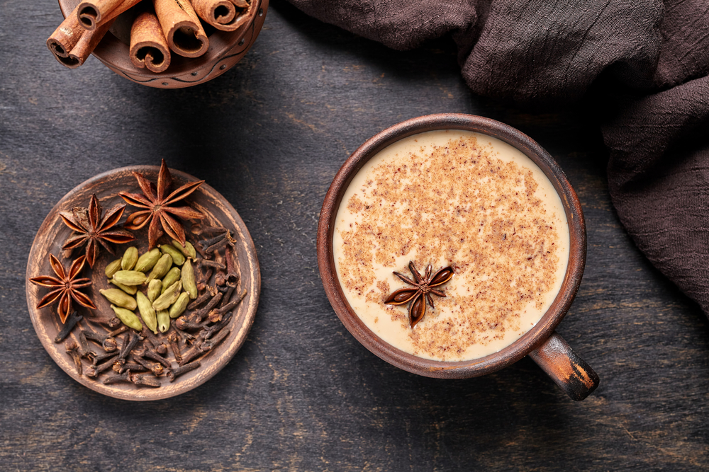 Masala tea chai latte traditional hot Indian sweet milk spiced drink with Anise