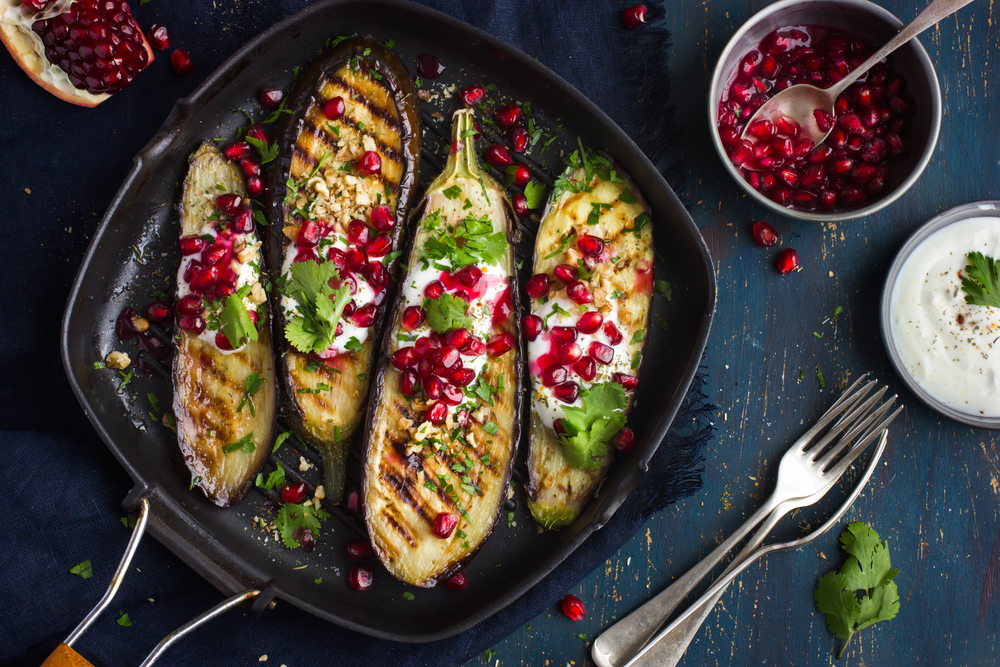 grilled eggplants with garlic yogurt sauce, walnuts and pomegranate