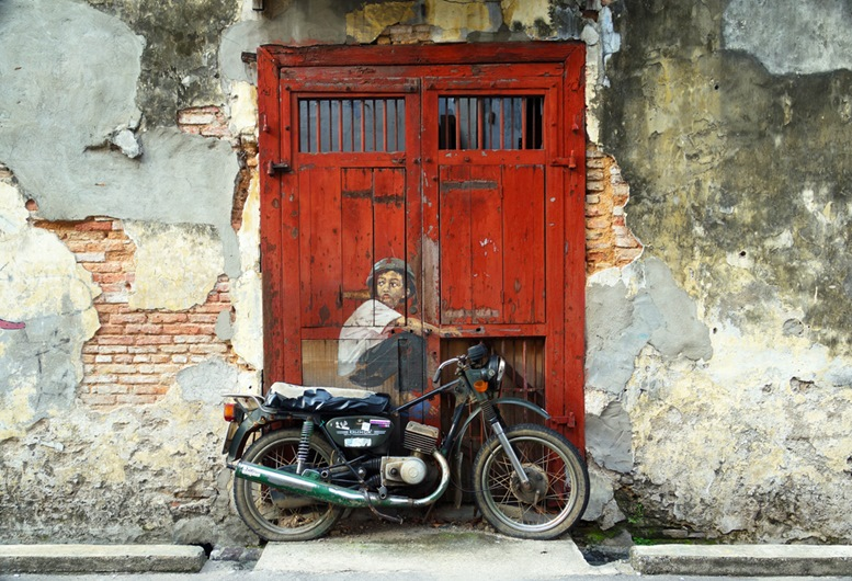 A mural 'Boy on a Bike' painted by Ernest Zacharevic