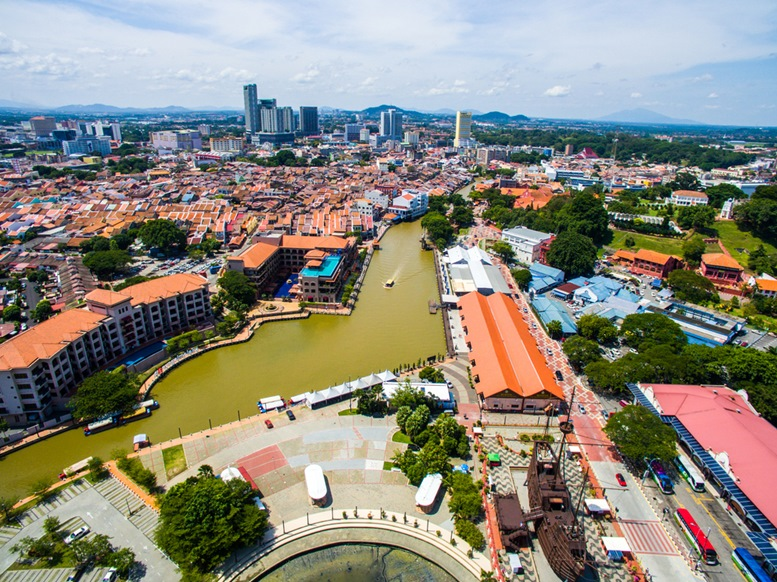 Aerial view of the Malacca river flowing through in between the busy city of Malacca