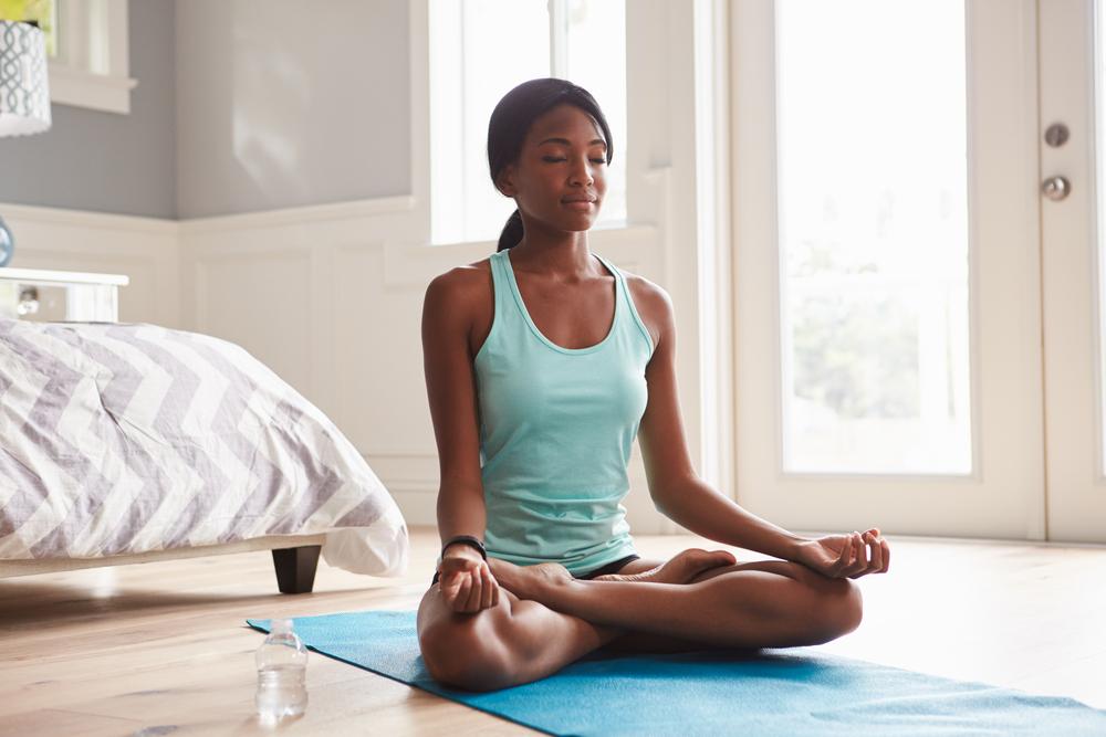 African girl doing yoga