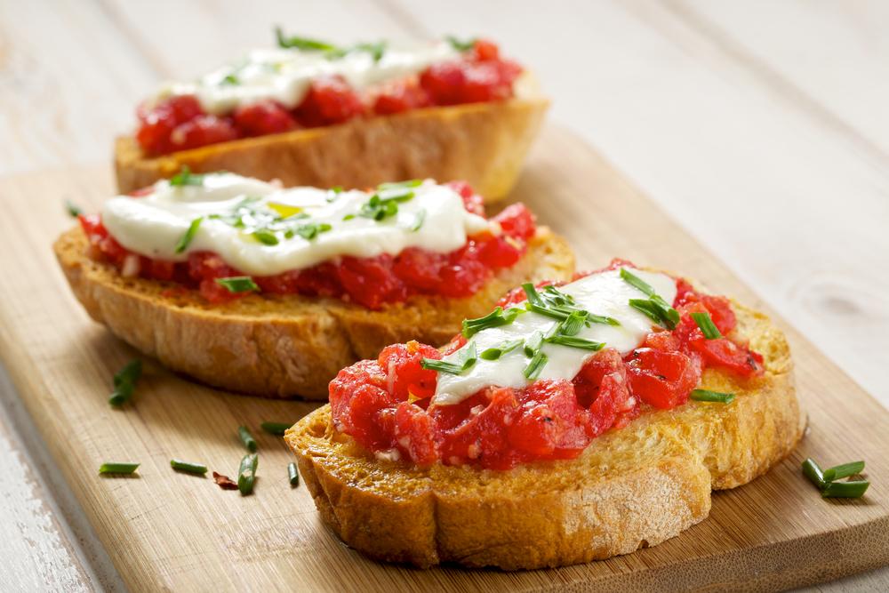 Bruschetta with tomato, mozarella and chive