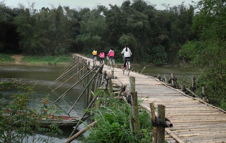 Children Cycling in Hue, Vietnam