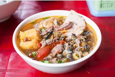 Close up of Vietnamese snail noodle soup.