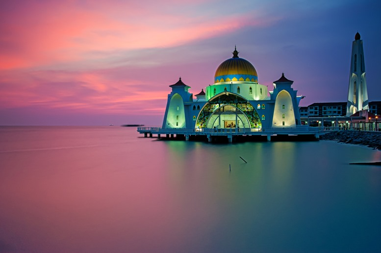 Malacca Straits Mosque ( Masjid Selat Melaka), It is a mosque located on the man-made Malacca Island near Malacca Town, Malaysia - Sunset View