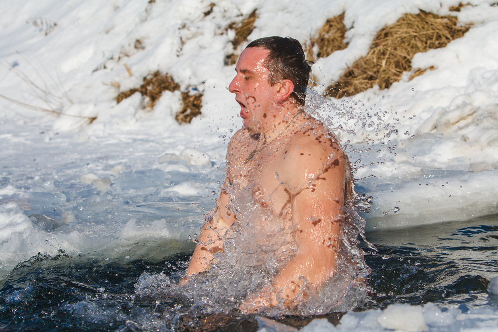 Man Bathing in Icy Cold Water
