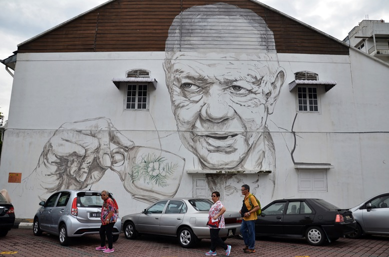 Old Man Drinking White Coffee painted by Ernest Zacharevic in Ipoh.
