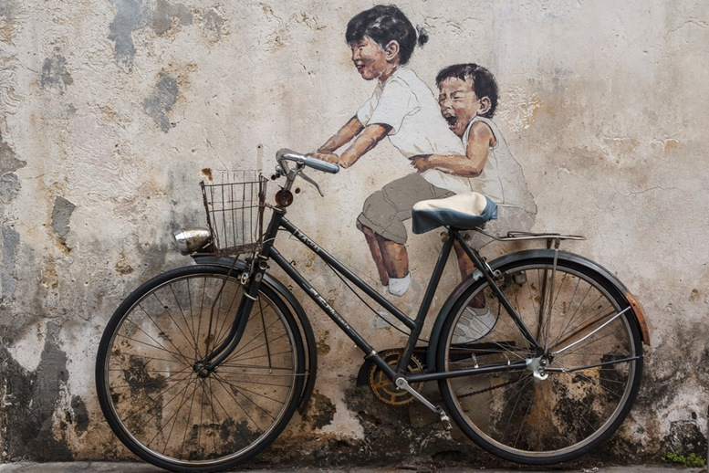 One of the famous murals on the walls of the old town of George Town in Malaysia