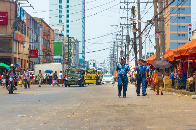 Police officers patrol Divisoria Market in Manila