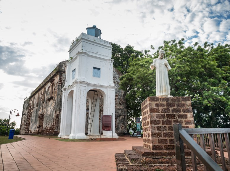 St. Paul's Church with a statue of St. Francis Xavier in Malacca, Malaysia