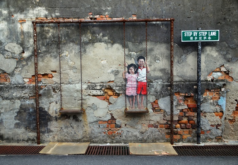 Street Mural titled 'Children on the Swing' painted by Louis Gan