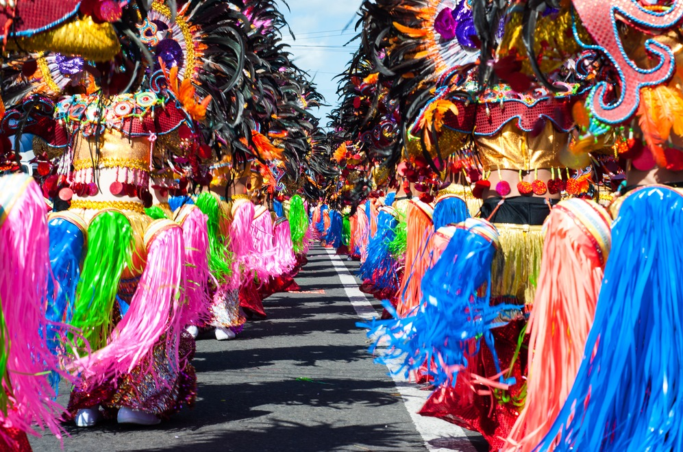 Street dancing parade of colorful mask and costume during the celebration of Masskara Festival at Bacolod City, Philippines