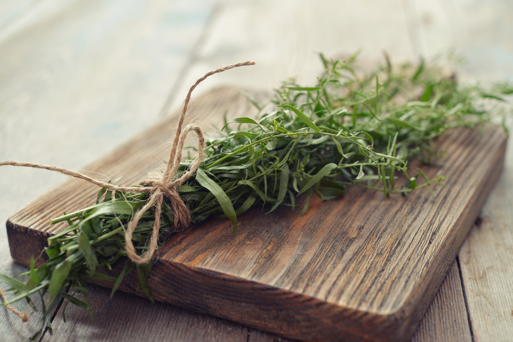 Tarragon on Wooden Choping Board