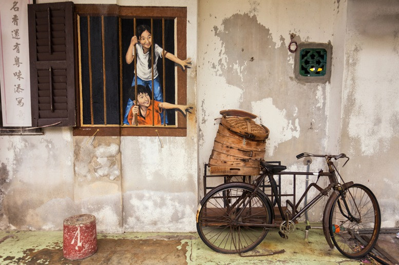 Wall artwork called Brother and Sister street art in George Town, Penang