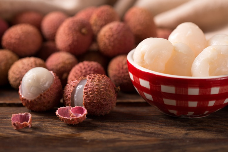 Fresh Lychees on a Wooden Table