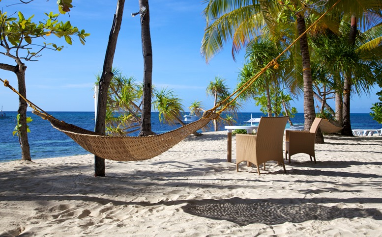 Hammock on a white sand tropical beach on Malapascua island
