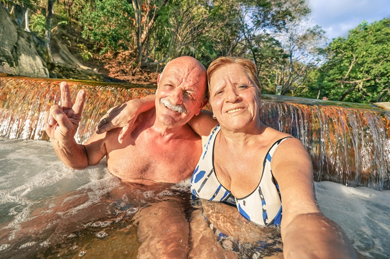 Happy Senior Couple Having a Great Time at Maquinit Springs, Coron
