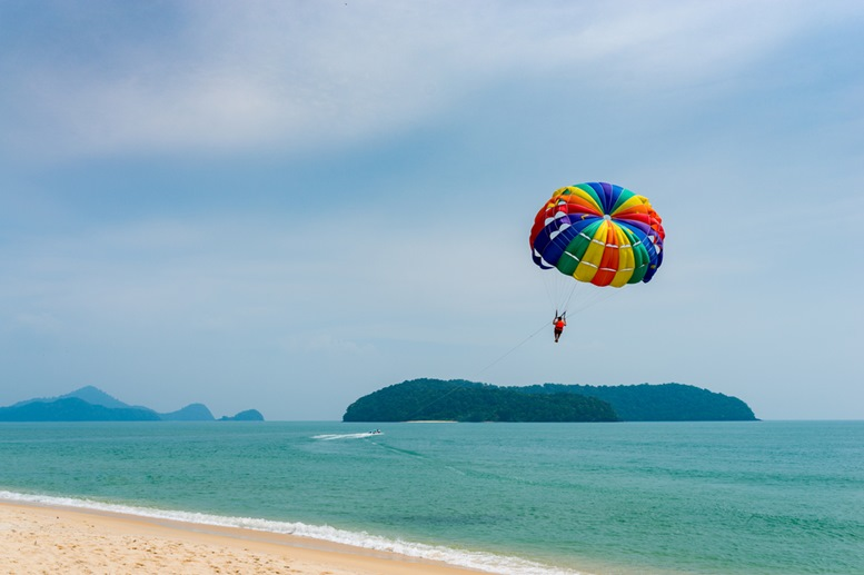 Parachute flying over the Andaman sea, Langkawi island