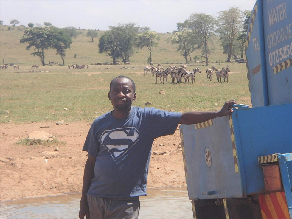 Patrick Kilonzo Mwalua with his water truck
