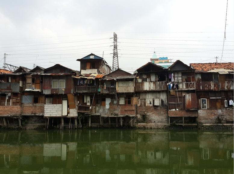Slum area on the riverbank in Jakarta.