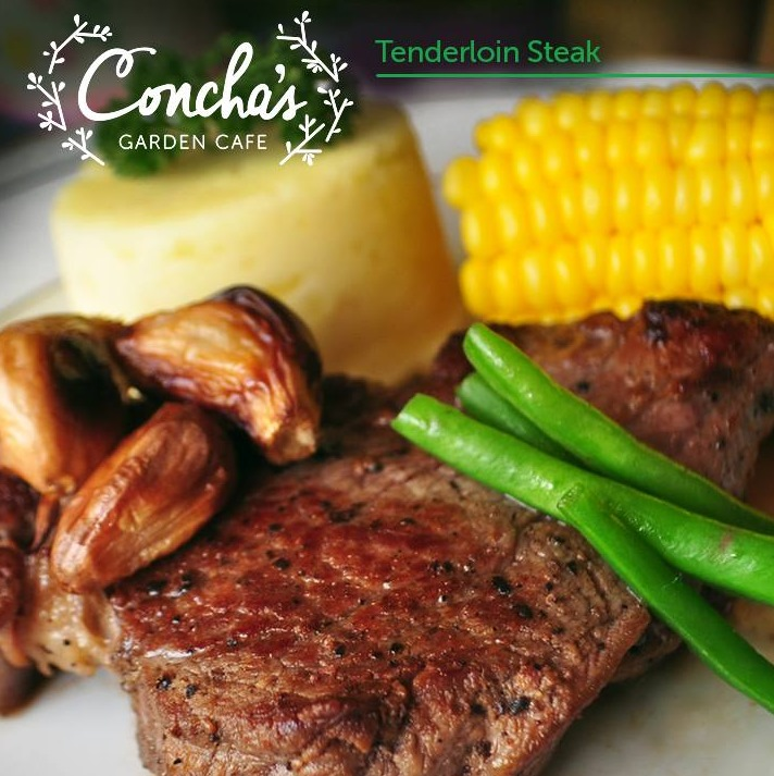 Tenderloin Steak topped with roasted garlic served with mashed potato & corn on the cob