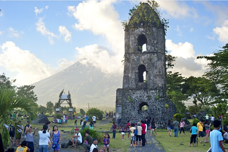 Tourists at Cagsawa Ruins. The Cagsawa Ruins are the remnants of church, built in 1724 and destroyed by the 1814 eruption of Mayon Volcano