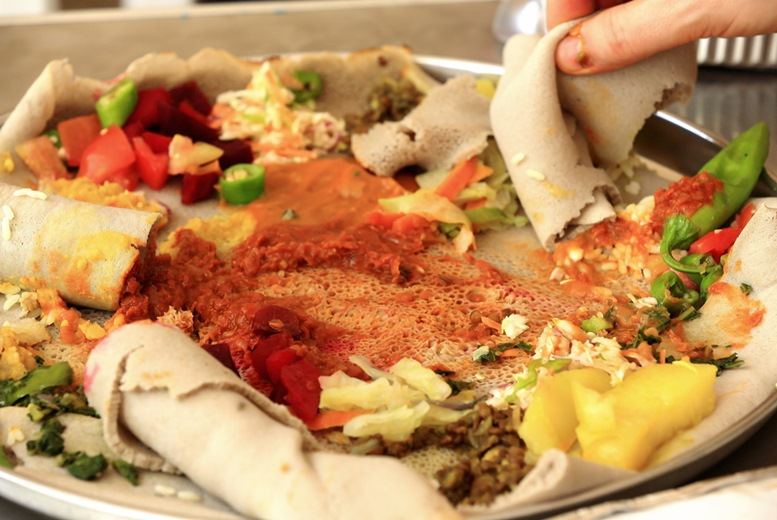 Typical ethiopian injera food made of teff cereal -eragrostis tef- with vegetables-tomato-potatoes-some meat.