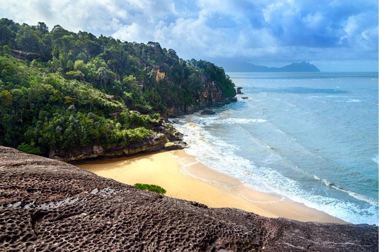 View on the beach from cliff. Telok padan kecil in Bako National Park
