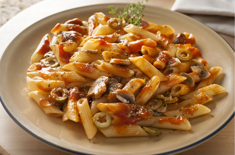 kamut penne with napolitana sauce and sliced champignons and olives